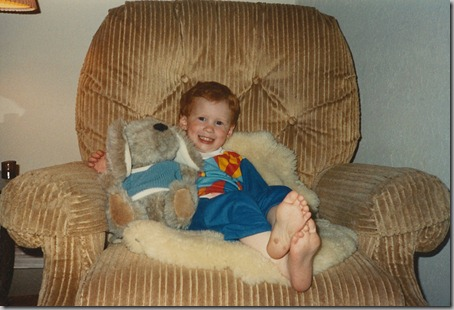 Nate in rocking chair with sheepskin