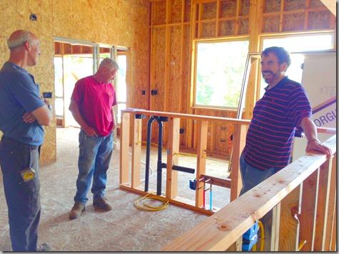 Three men looking at plumbing and wiring 7-20-13