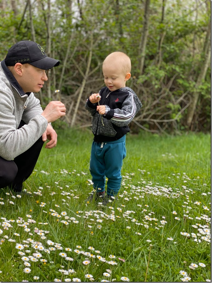 Nate and Quinn with Flowers in Wetlands Meadow 4-26-20
